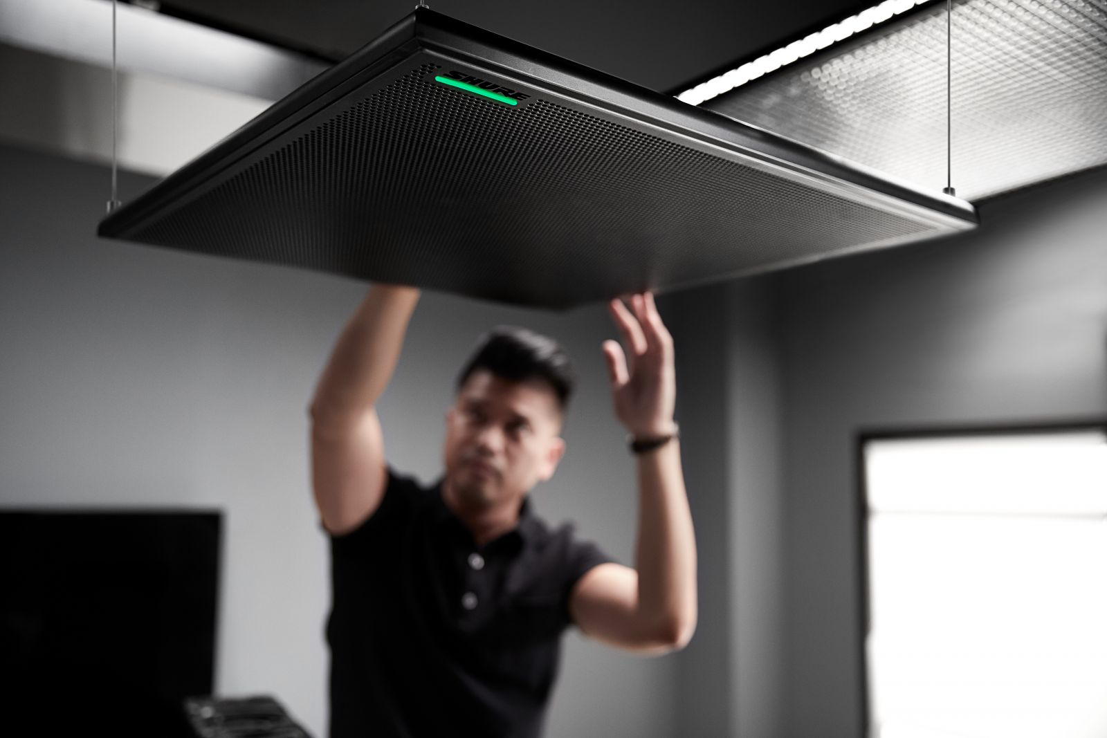 MXA910 being hung on ceiling