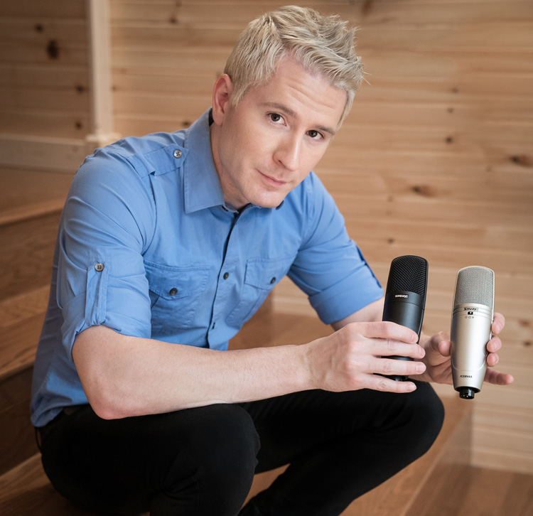 Adam Young Holds two shure microphones