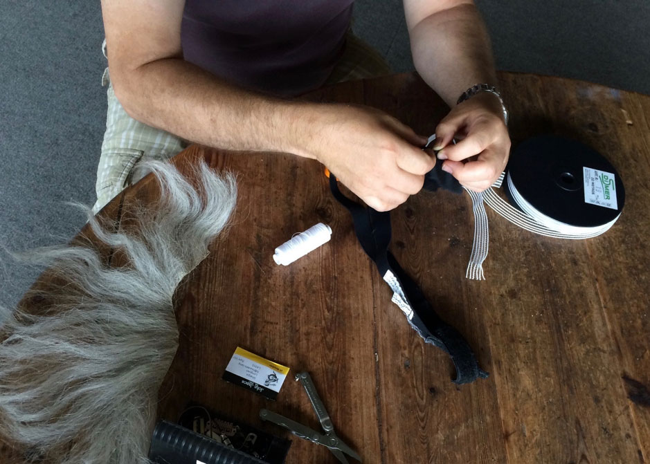 Mic Being Sewn into Hidden Hair Pouch