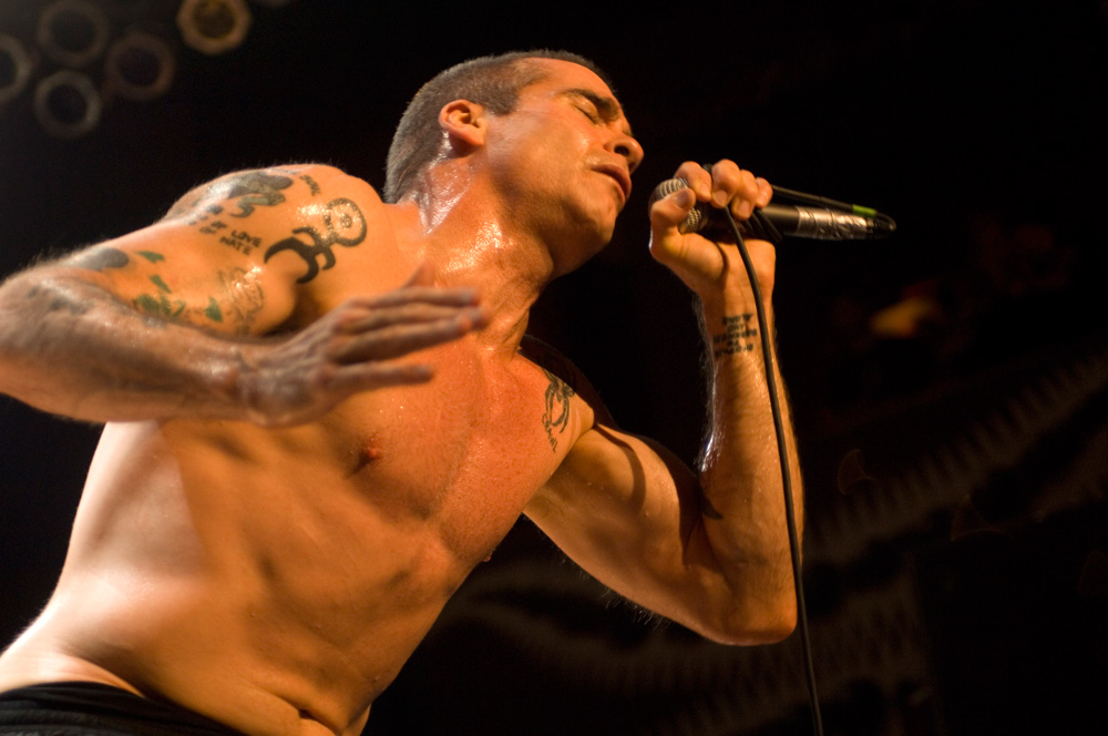Henry Rollins Singing into his SM58
