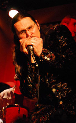 Dennis Gruenling and one of his many vintage Shure 'bullets'